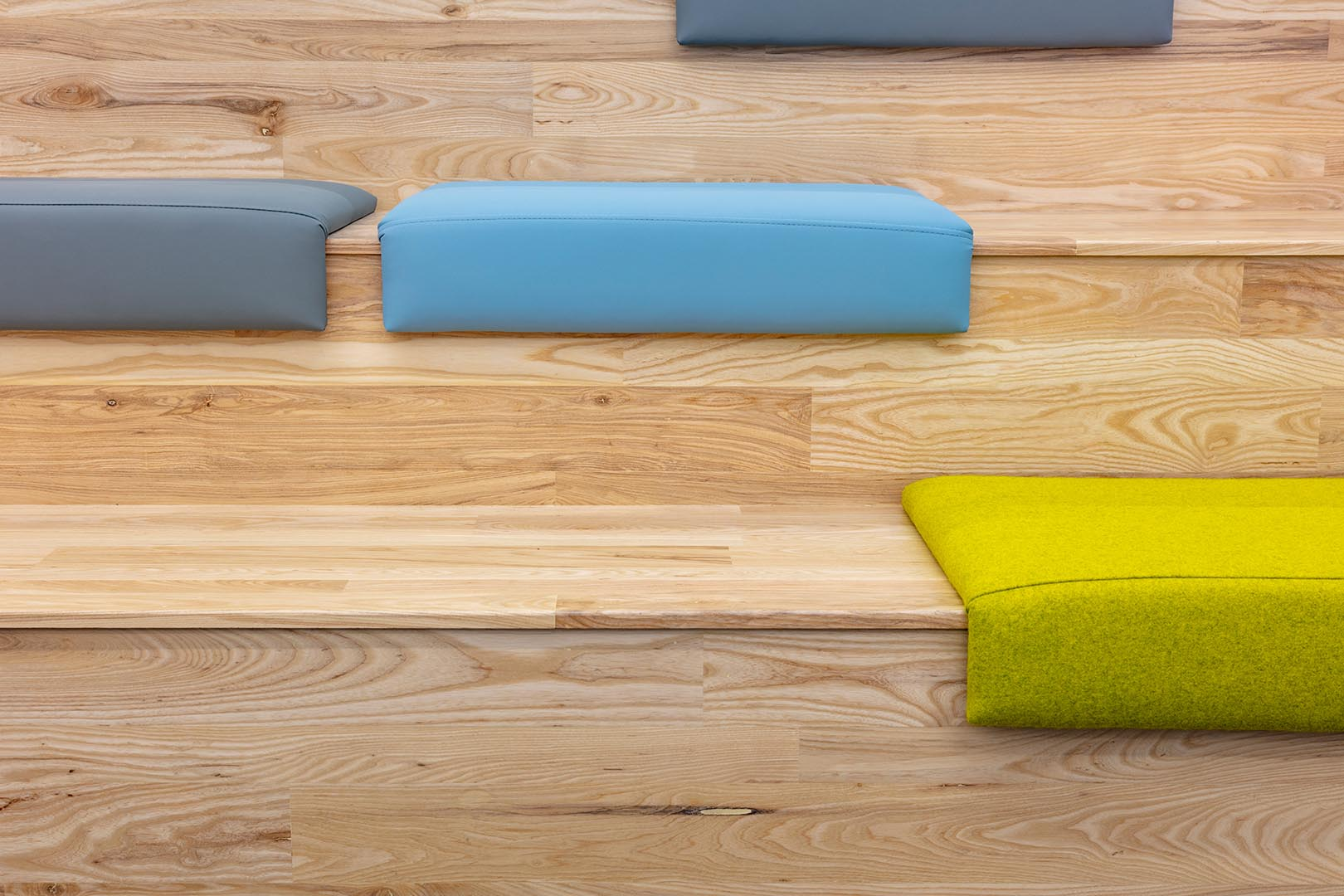 Cool toned cushions on benches in the Redbridge branch public library