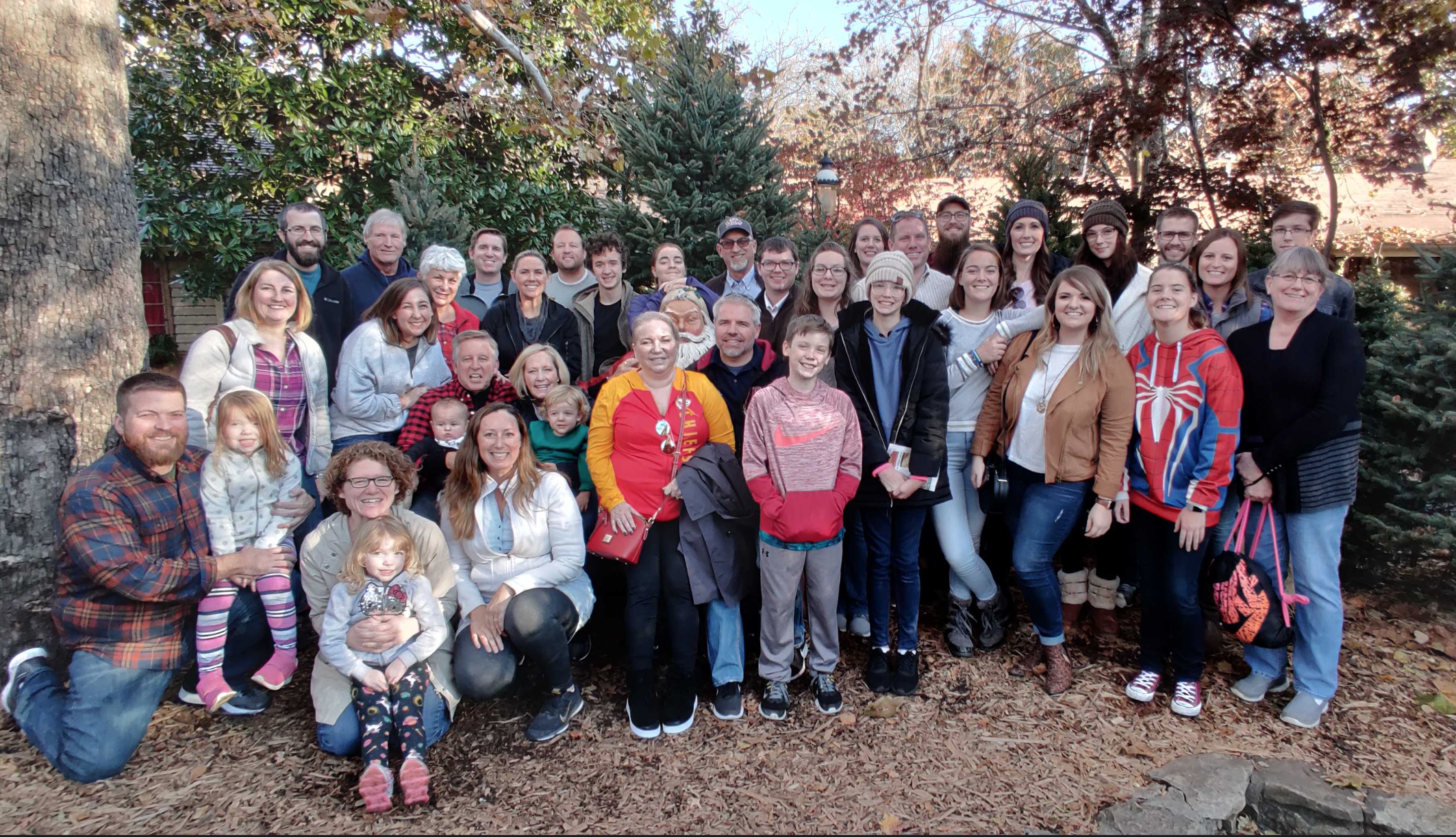 Family members of Sapp Design Architects group photo outdoors in winter